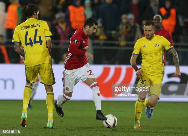 Henrikh Mkhitaryan of Manchester United in action with Cesar Navas and Fedor Kudryashov of FK Rostov during the UEFA Europa League Round of 16 first...