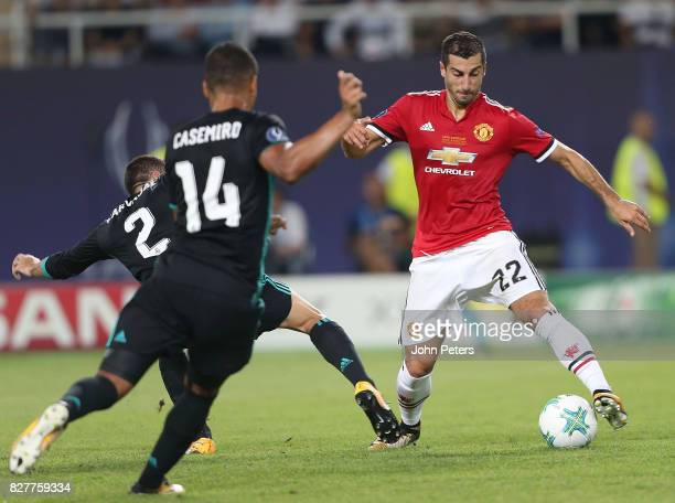 Henrikh Mkhitaryan of Manchester United in action with Dani Carvajal and Casemiro of Real Madrid during the UEFA Super Cup match between Real Madrid...