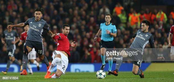 Henrikh Mkhitaryan of Manchester United in action with Eduardo Salvio of Benfica during the UEFA Champions League group A match between Manchester...