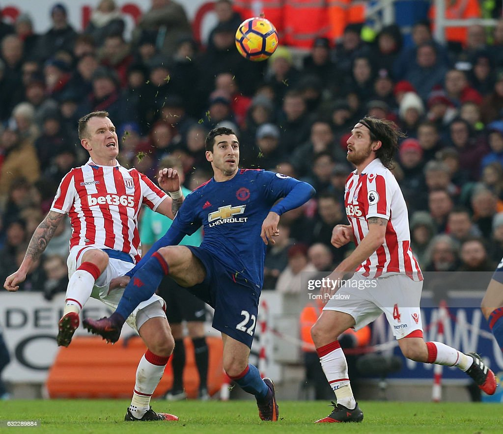 Henrikh Mkhitaryan of Manchester United in action with Glenn Whelan and Joe Allen of Stoke City during the Premier League match between Stoke City and Manchester United at Bet365 Stadium on January 21, 2017 in Stoke on Trent, England.