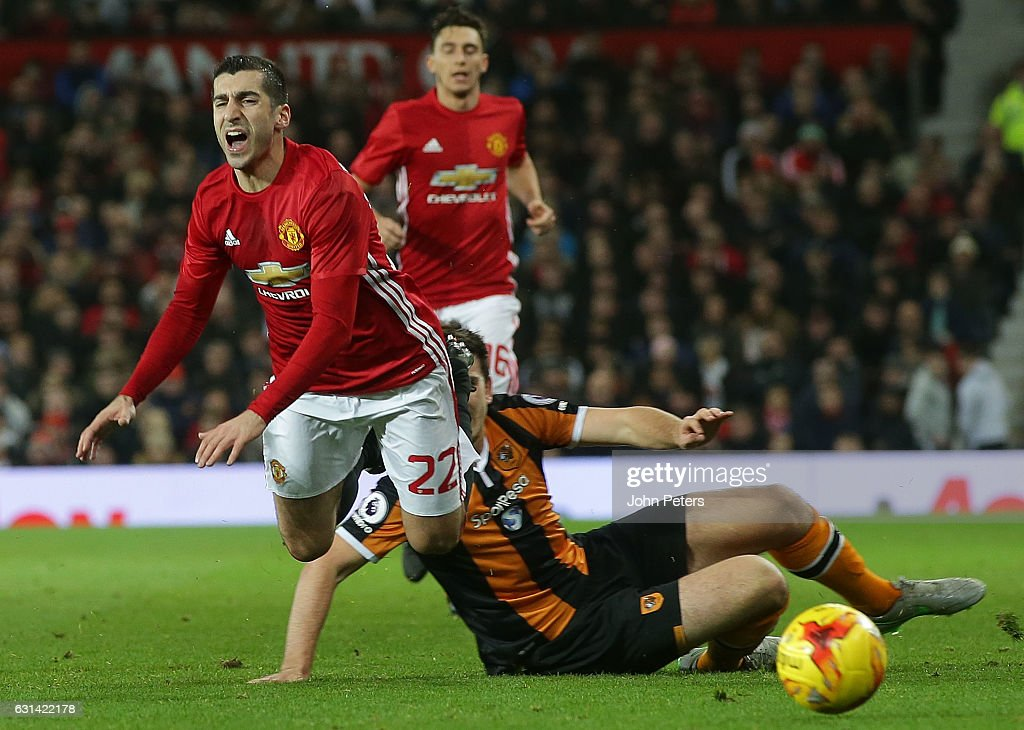Henrikh Mkhitaryan of Manchester United in action with Harry McGuire of Hull City during the EFL Cup Semi-Final first leg match between Manchester United and Hull City at Old Trafford on January 10, 2017 in Manchester, England.