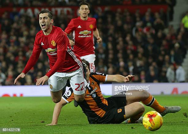 Henrikh Mkhitaryan of Manchester United in action with Harry McGuire of Hull City during the EFL Cup Semi-Final first leg match between Manchester...
