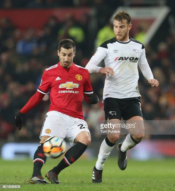 Henrikh Mkhitaryan of Manchester United in action with Johnny Russell and Richard Keogh of Derby County during the Emirates FA Cup Third Round match...