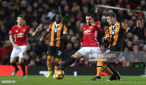 Henrikh Mkhitaryan of Manchester United in action with Josh Tymon of Hull City during the Premier League match between Manchester United and Hull...