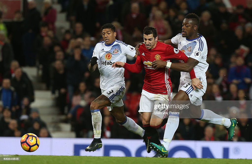 Henrikh Mkhitaryan of Manchester United in action with Patrick van Aanholt and Lamine Kone of Sunderland during the Premier League match between Manchester United and Sunderland at Old Trafford on December 26, 2016 in Manchester, England.