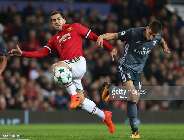 Henrikh Mkhitaryan of Manchester United in action with Ruben Dias of Benfica during the UEFA Champions League group A match between Manchester United...