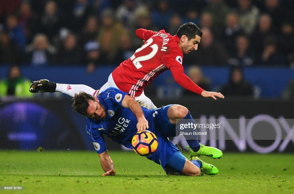 Henrikh Mkhitaryan of Manchester United is challenged by Christian Fuchs of Leicester City during the Premier League match between Leicester City and Manchester United at The King Power Stadium on February 5, 2017 in Leicester, England.