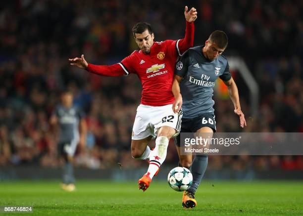 Henrikh Mkhitaryan of Manchester United is challenged by Ruben Dias of Benfica during the UEFA Champions League group A match between Manchester...