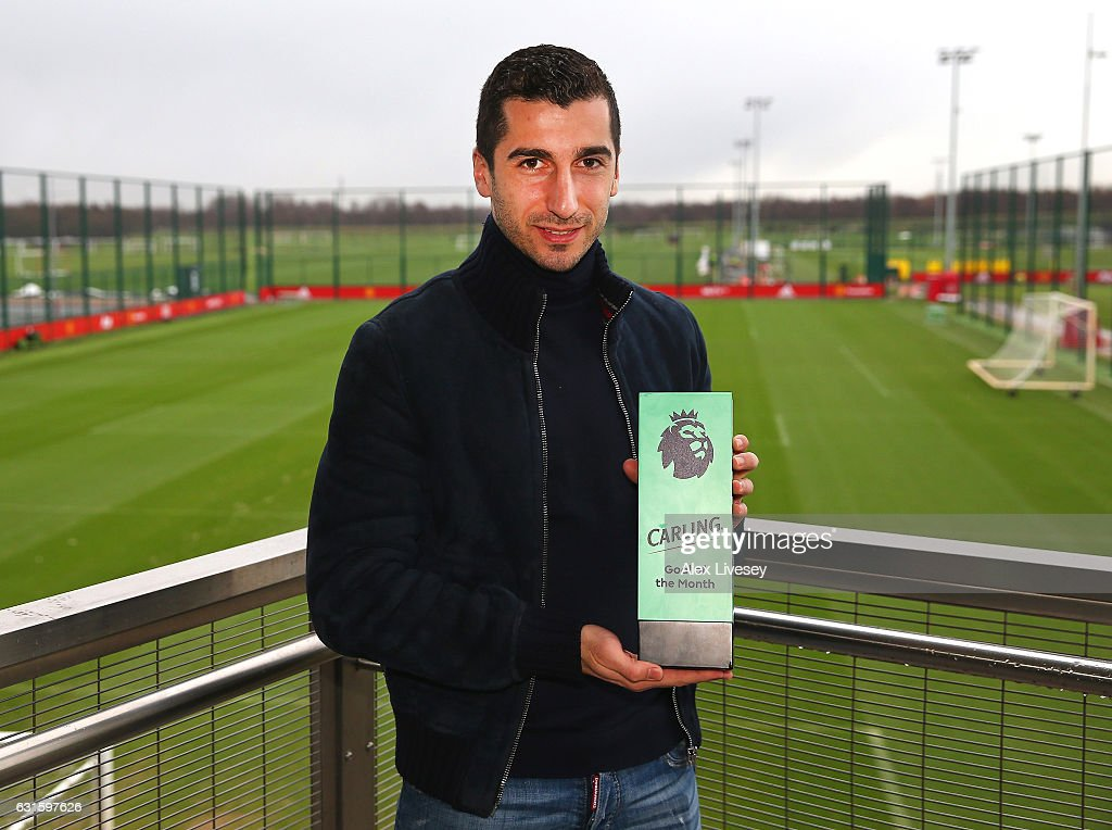 Henrikh Mkhitaryan of Manchester United is presented with the Carling Premier League Goal of the Month Award at Aon Training Complex on January 12, 2017 in Manchester, England.