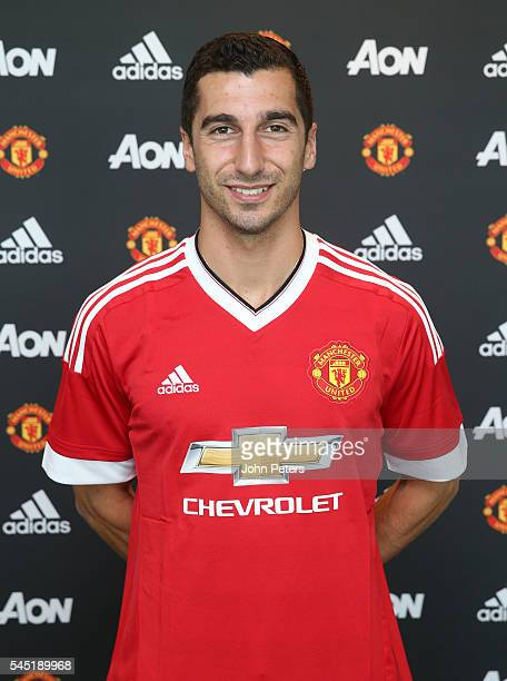 Henrikh Mkhitaryan of Manchester United poses after signing for the club at Aon Training Complex on July 6 2016 in Manchester England