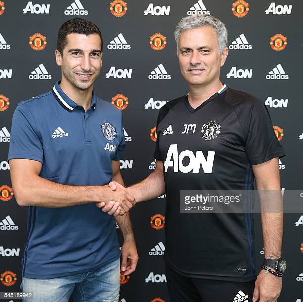 Henrikh Mkhitaryan of Manchester United poses with Manager Jose Mourinho after signing for the club at Aon Training Complex on July 6 2016 in...