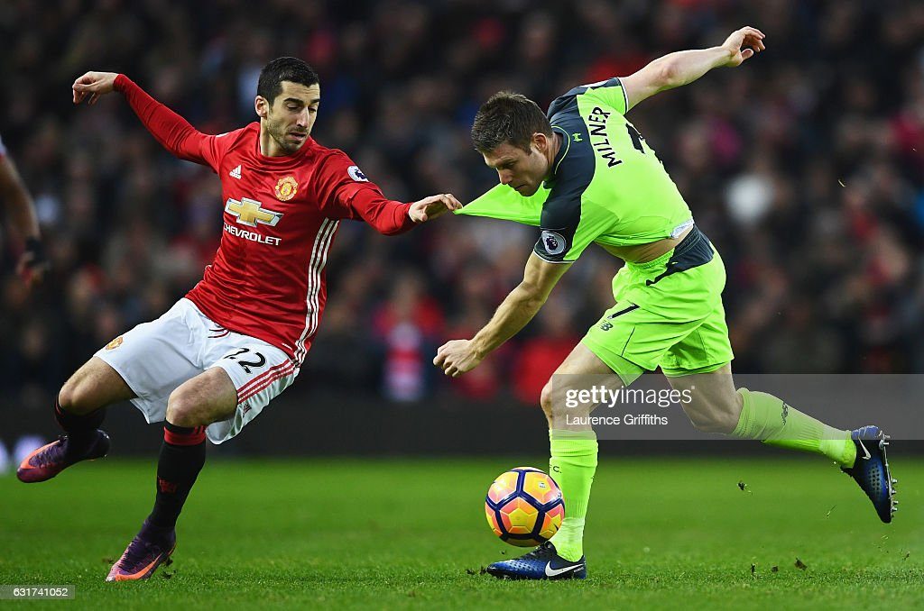 Henrikh Mkhitaryan of Manchester United pulls the shirt of James Milner of Liverpool as they battle for the ball during the Premier League match between Manchester United and Liverpool at Old Trafford on January 15, 2017 in Manchester, England.
