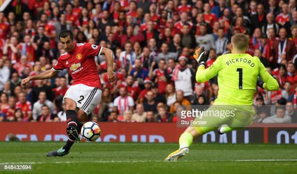 Henrikh Mkhitaryan of Manchester United scores his sides second goal past Jordan Pickford of Everton during the Premier League match between...