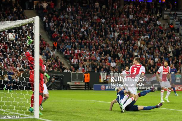 Henrikh Mkhitaryan of Manchester United scores the second goal to make the score 02 during the UEFA Europa League Final between Ajax and Manchester...