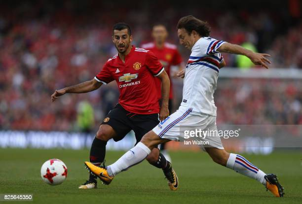 Henrikh Mkhitaryan of Manchester United tries to tackle Edgar Barreto of Sampdoria during the International Champions Cup match between Manchester...