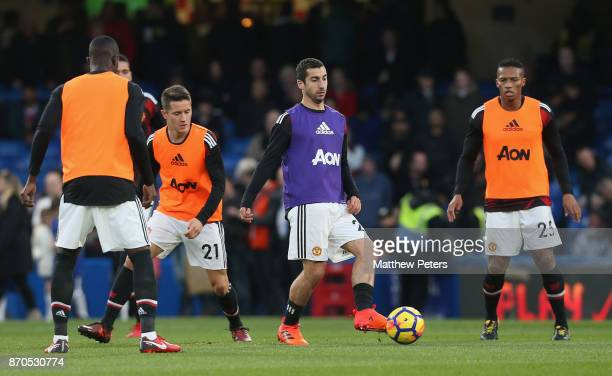 Henrikh Mkhitaryan of Manchester United warms up ahead of the Premier League match between Chelsea and Manchester United at Stamford Bridge on...