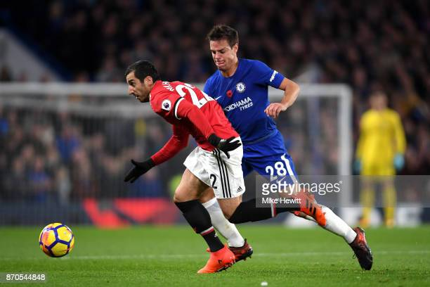 Henrikh Mkhitaryan of Mancheter United and Cesar Azpilicueta of Chelsea battle for possession during the Premier League match between Chelsea and...