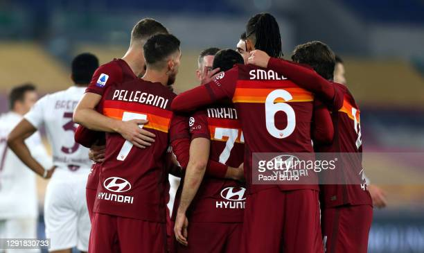 Henrikh Mkhitaryan of Roma celebrates with team mates after scoring their sides first goal during the Serie A match between AS Roma and Torino FC at...
