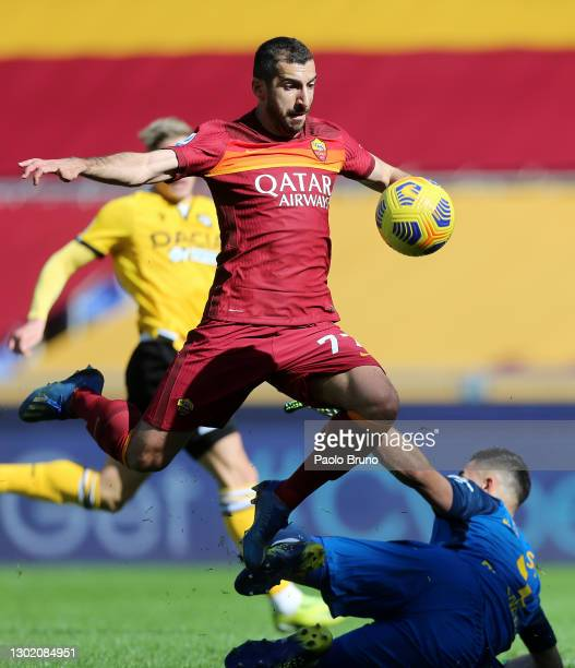 Henrikh Mkhitaryan of Roma is fouled by Juan Musso of Udinese Calcio resulting in a penalty during the Serie A match between AS Roma and Udinese...