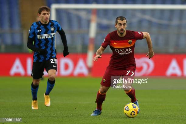 Henrikh Mkhitaryan of Roma on the ball as he is closed down by Nicolo Barella of Internazionale during the Serie A match between AS Roma and FC...