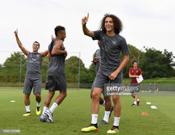 Henrikh Mkhitaryan PierreEmerick Aubameyang and Matteo Guendouzi of Arsenal during a training session at London Colney on July 16 2018 in St Albans...