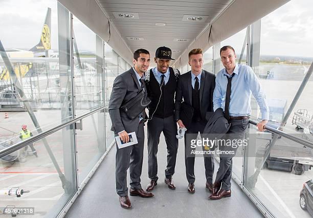 Henrikh Mkhitaryan PierreEmerick Aubameyang Marco Reus and Kevin Grosskreutz of Borussia Dortmund at the Dortmund airport prior to their UEFA...