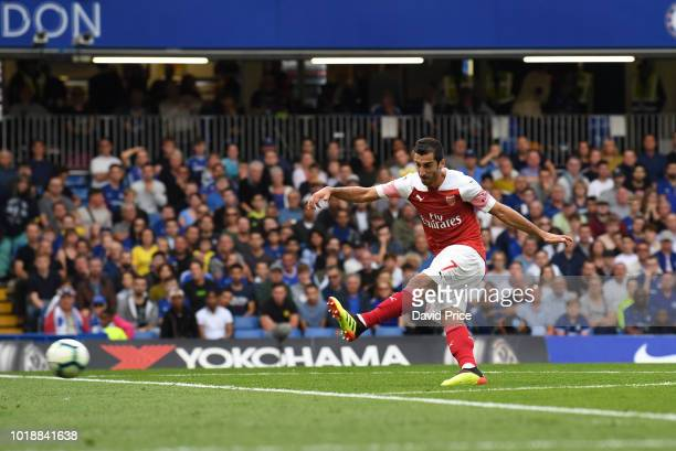 Henrikh Mkhitaryan scores Arsenal's 1st goal during the Premier League match between Chelsea FC and Arsenal FC at Stamford Bridge on August 18 2018...
