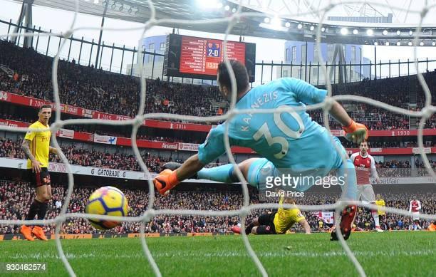 Henrikh Mkhitaryan scores Arsenal's 3rd goal past Orestis Karnezis of Watford during the Premier League match between Arsenal and Watford at Emirates...