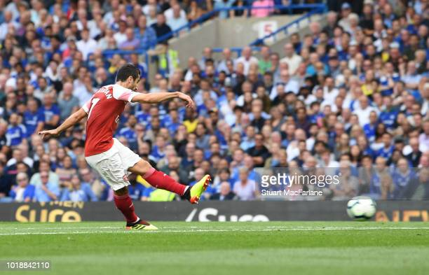 Henrikh Mkhitaryan scores the 1st Arsenal goal during the Premier League match between Chelsea FC and Arsenal FC at Stamford Bridge on August 18 2018...