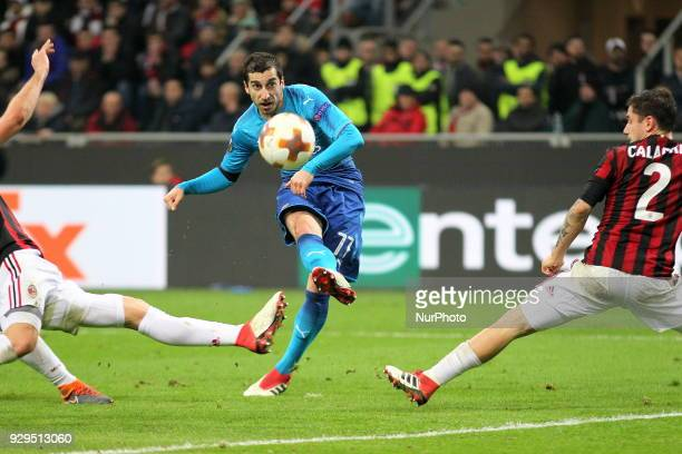 Henrikh Mkhitaryan scores the opening goal during the first leg of the round 16 of the UEFA Europa League 2017/18 between AC Milan and Arsenal FC at...