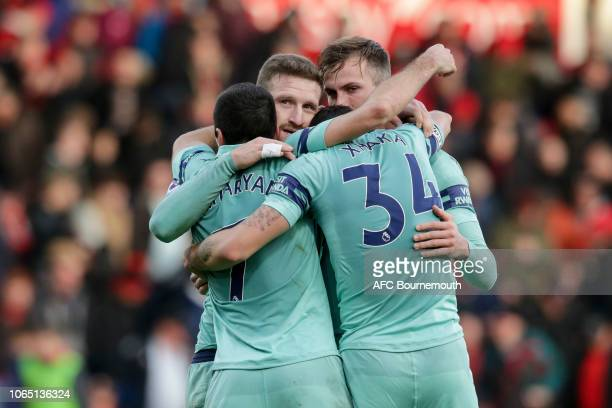 Henrikh Mkhitaryan Shkodran Mustafi Rob Holding and GranitXhaka of Arsenal celebrate their sides 21 win during the Premier League match between AFC...