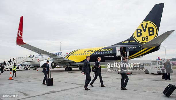 Henrikh Mkhitaryan Sven Bender Marc Hornschuh and Lukasz Piszczek of Borussia Dortmund coming out of the airplane at the London airport prior to...