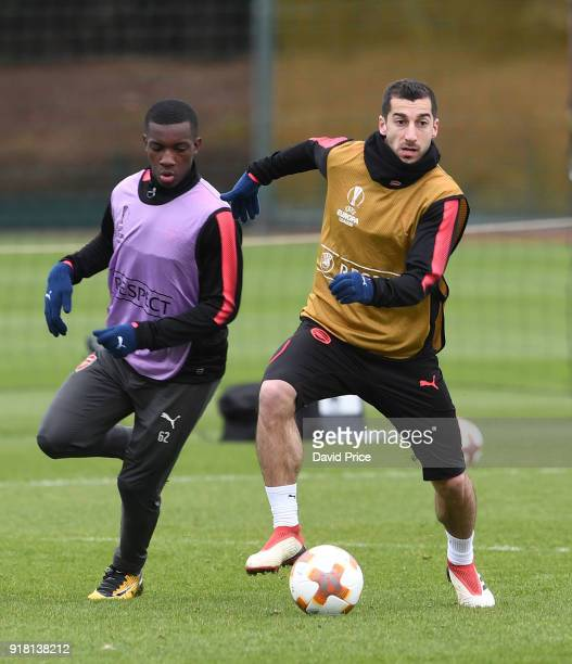 Henrikh Mkhitaryan takes on Eddie Nketiah of Arsenal during the Arsenal training session at London Colney on February 14 2018 in St Albans England