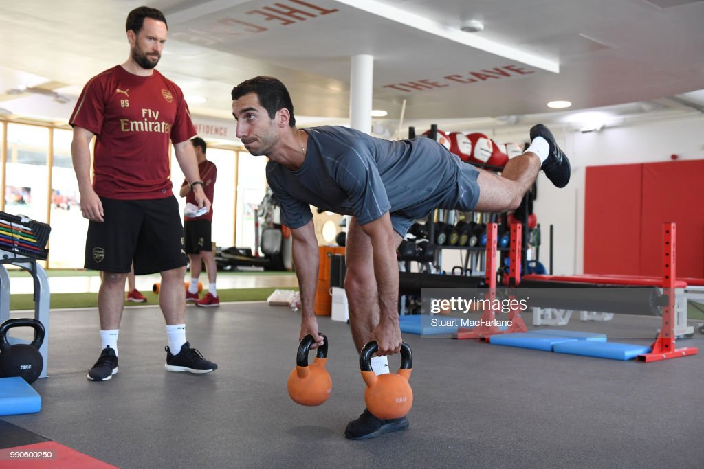 Henrikh Mkhitaryan with Arsenal fitness coach Barry Solan during a medical screening session at London Colney on July 3, 2018 in St Albans, England.