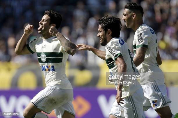 Henrique Almeida of Coritiba celebrates a scored goal with Tiago Real and Dodô during the match between Botafogo and Coritiba as part of Brasileirao...
