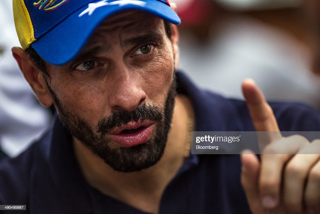 Henrique Capriles, governor of the state of Miranda and a former presidential candidate in the last two elections, speaks during an interview while visiting with constituents in Barlovento, Venezuela, on Saturday, May 10, 2014. Capriles, one of the leaders of the Democratic Unity Roundtable, known as MUD, an alliance which opposes Venezuelan President Nicolas Maduro, said talks with the government scheduled for May 8 were canceled because they 'haven't produced any result up to now.' Photographer: Meridith Kohut/Bloomberg via Getty Images