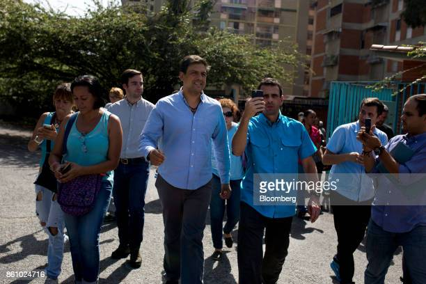 Henrique Capriles opposition leader and former governor of the State of Miranda center right uses a smartphone to live stream with periscope the...