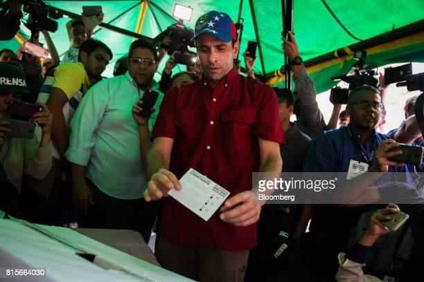 Henrique Capriles opposition leader and governor of the State of Miranda casts a ballot at a polling station during a symbolic plebiscite in Caracas...