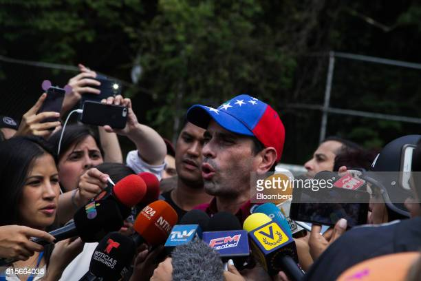Henrique Capriles opposition leader and governor of the State of Miranda speaks to members of the media at a polling station during a symbolic...