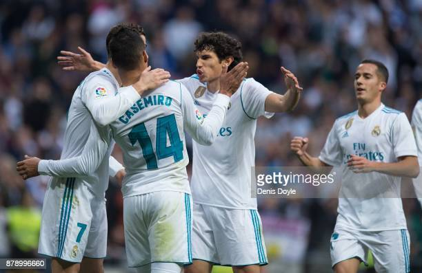 Henrique Casemiro of Real Madrid CF celebrates with teammates Cristiano Ronaldo and Jesus Vallejo and Lucas Vazquez of Real Madrid CF of Real Madrid...