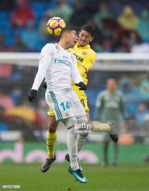 Henrique Casemiro of Real Madrid challenges Pablo Fornals of Villareal CF during the La Liga match between Real Madrid and Villarreal at Estadio...