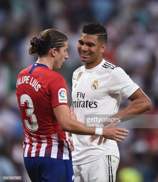 Henrique Casemiro of Real Madrid chats with Filipe Luis of Club Atletico de Madrid during the La Liga match between Real Madrid CF and Club Atletico...