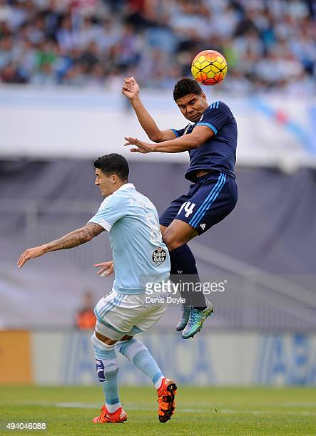 Henrique Casemiro of Real Madrid heads the ball beside Pablo Hernandez of Celta Vigo during the La Liga match between Celta Vigo and Real Madrid at...