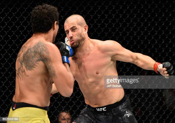 Henrique da Silva of Brazil punches Gokhan Saki of Netherlands in their light heavyweight bout during the UFC Fight Night event inside the Saitama...