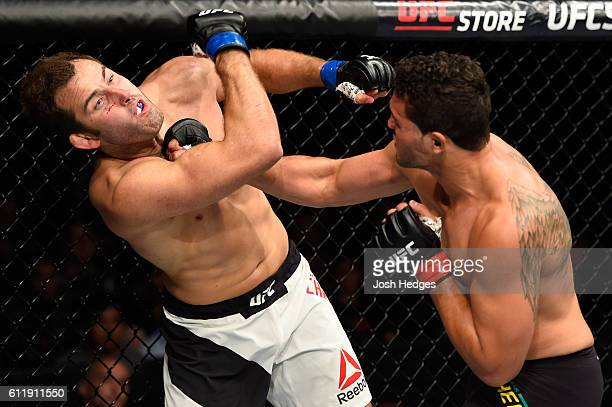 Henrique da Silva of Brazil punches Joachim Christensen of Denmark in their light heavyweight bout during the UFC Fight Night event at the Moda...