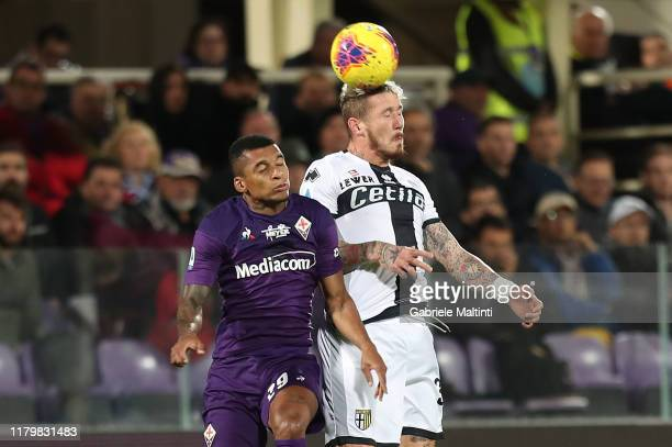 Henrique Dalbert of ACF Fiorentina battles for the ball with Juraj Kucka of Parma Calcio during the Serie A match between ACF Fiorentina and Parma...