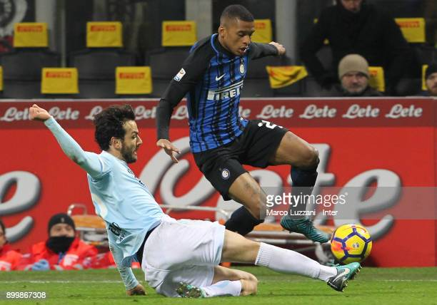 Henrique Dalbert of FC Internazionale competes for the ball with Marco Parolo of SS Lazio during the serie A match between FC Internazionale and SS...
