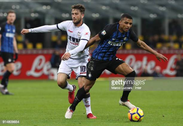 Henrique Dalbert of FC Internazionale competes for the ball with Andrea Barberis of FC Crotone during the serie A match between FC Internazionale and...