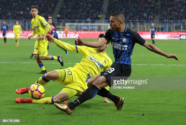 Henrique Dalbert of FC Internazionale Milano is challenged by Nenad Tomovic of AC Chievo Verona during the Serie A match between FC Internazionale...