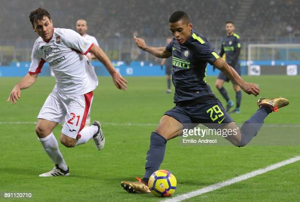 Henrique Dalbert of FC Internazionale Milano is challenged by Gianvito Misuraca of Pordenone Calcio during the TIM Cup match between FC...